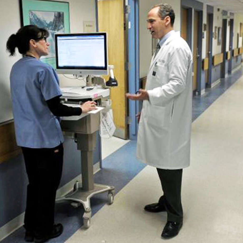 Dr Thomas Koobatian, the director of emergency medicine and the executive director and chief of staff at New Milford Hospital, talks with registered nurse Deirdre Fitzpatrick in the facility's current emergency department. April 2015 Photograph by John Voorhees III Photo: Contributed Photo / Contributed Photo / The News-Times Contributed