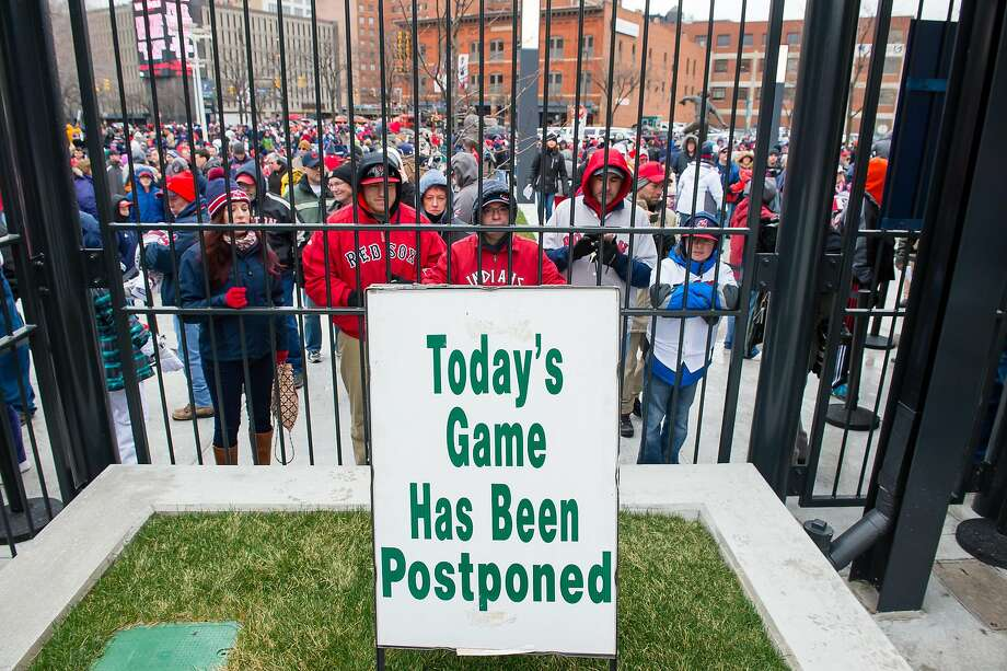 CLEVELAND, OH -  APRIL 4: Fans wait out side Progressive Field after what was supposed to be the opening day game between the Boston Red Sox v Cleveland Indians on April 4, 2016 in Cleveland, Ohio. The game was postponed due to inclement weather and will be played on April 5th. (Photo by Jason Miller/Getty Images) Photo: Jason Miller, Getty Images