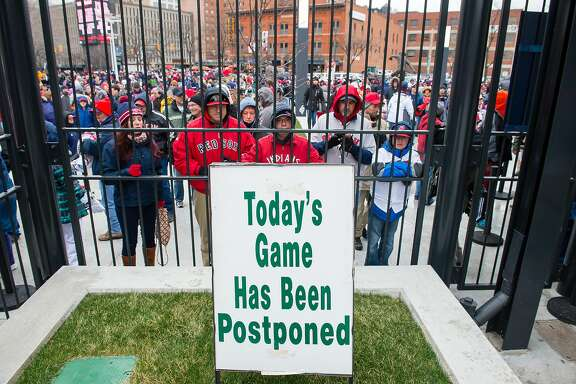CLEVELAND, OH -  APRIL 4: Fans wait out side Progressive Field after what was supposed to be the opening day game between the Boston Red Sox v Cleveland Indians on April 4, 2016 in Cleveland, Ohio. The game was postponed due to inclement weather and will be played on April 5th. (Photo by Jason Miller/Getty Images)
