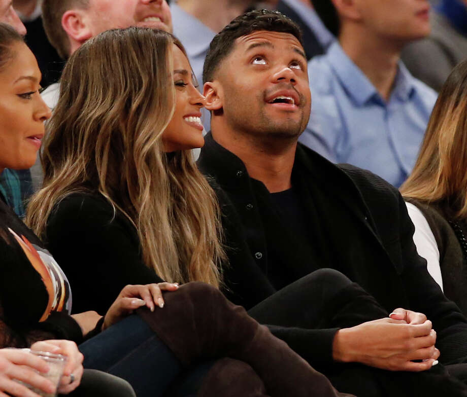 Singer Ciara, left, and Seattle Seahawks quarterback Russell Wilson look at a a huge video screen as they sit courtside in the first half of an NBA basketball game between the New York Knicks and the Washington Wizards at Madison Square Garden in New York, Tuesday, Feb. 9, 2016. (AP Photo/Kathy Willens) Photo: Kathy Willens, Associated Press / AP