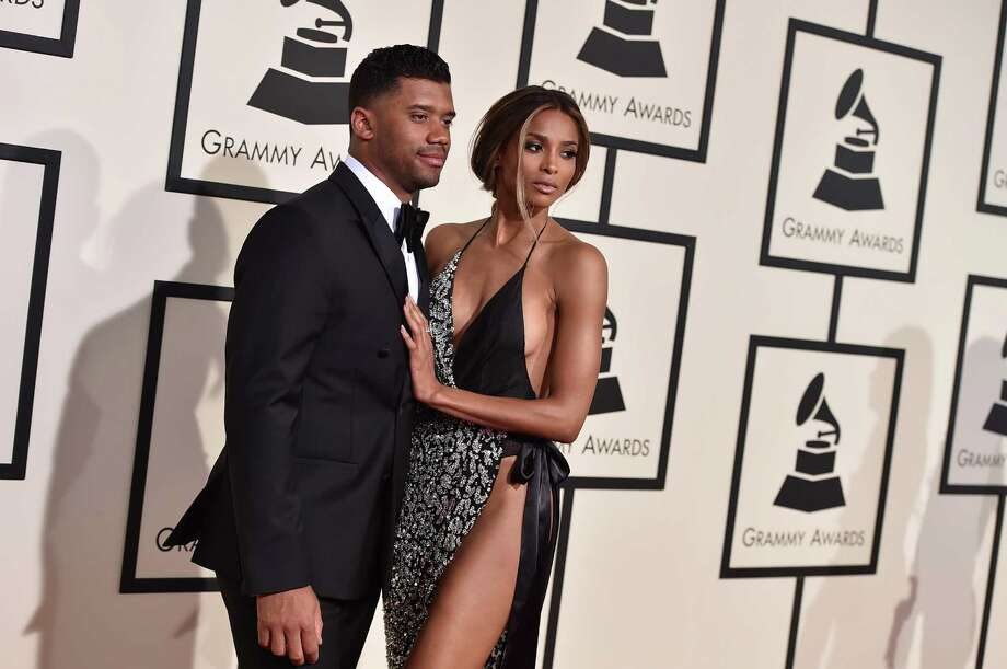 Russell Wilson, left, and Ciara arrive at the 58th annual Grammy Awards at the Staples Center on Monday, Feb. 15, 2016, in Los Angeles. (Photo by Jordan Strauss/Invision/AP) Photo: Jordan Strauss, Associated Press / Invision