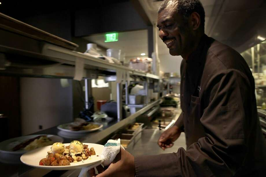 Chef-owner David Lawrence serves up eggs Benedict with hot sauce at brunch at 1300 on Fillmore. Photo: Lacy Atkins, The Chronicle