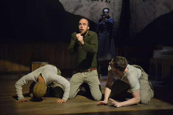 """CJ (Christopher Livingston, left) Big Joe (Ian Merrigan) and Coughlin (Jon Beavers)face the horrors of war in """"The Unfortunates"""" at ACT (L-R): CJ (Christopher Livingston), Big Joe (Ian Merrigan), and Coughlin (Jon Beavers) face the horrors of war in The Unfortunates, playing at A.C.T.'s Strand Theater through Sunday, April 10. (Background: Ramiz Monsef). Photo by Kevin Berne."""