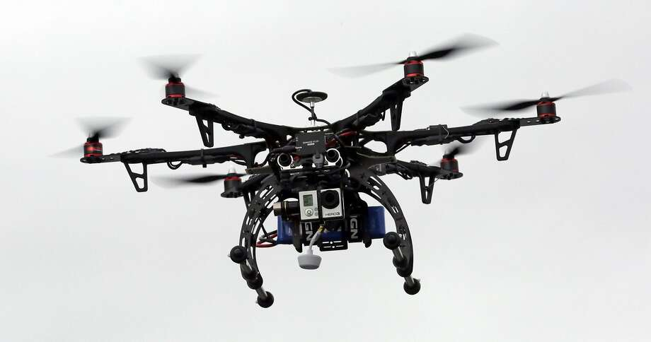 A panel has recommended regulations to the FAA that would allow commercial drones to fly over populated areas to deliver packages. Photo: Rick Bowmer, AP
