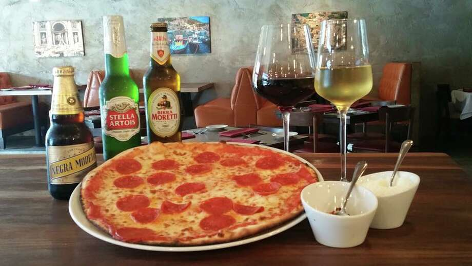 Enoteca Rossa Ristorante Italiano is now open at 4566 Bissonnet in Bellaire is an Italian restaurant with a day-long menu beginning with breakfast baked goods and paninis, and casual lunches and dinners with a menu of salads, soups, pasta, and wood-fired pizza. Photo: Enoteca Rossa