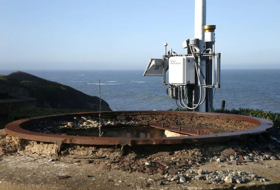 An automated National Weather Service weather station collects data on a bluff overlooking the Pacific Ocean next to an old military battery in Montara. Photo: Paul Chinn, The Chronicle