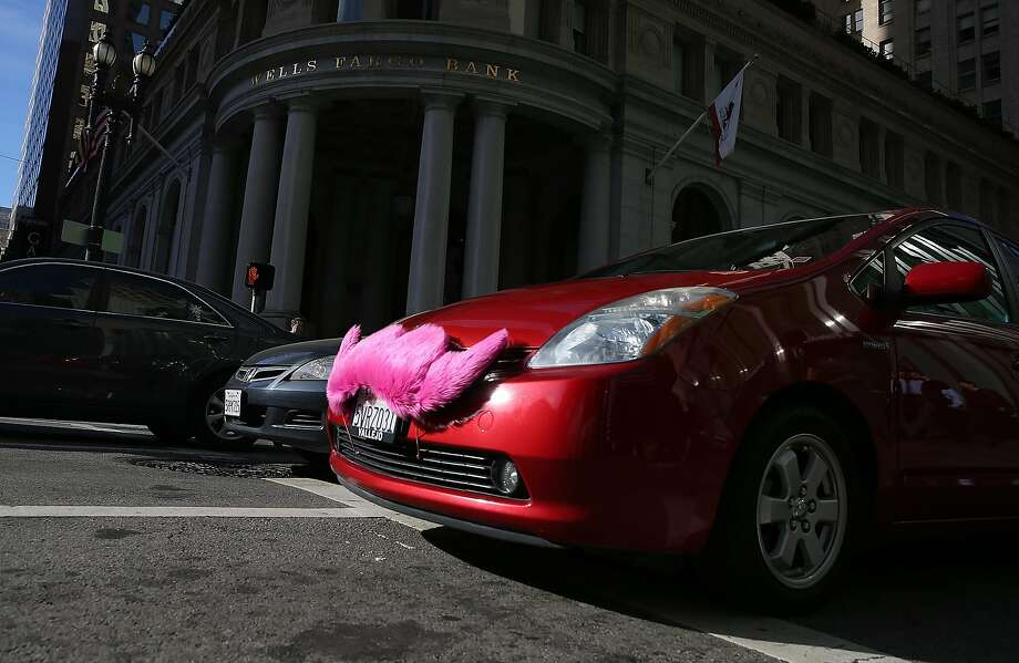 A Lyft car drives along Montgomery Street on January 21, 2014 in San Francisco, California. Photo: Justin Sullivan, Getty Images