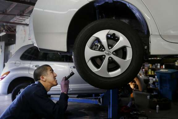 Mechanic Lanh Nguyen checks suspension and bushings on the Prius Wednesday April 8, 2015. San Francisco Auto Repair is an authorized inspection service center for personal cars driven for UberX. The technician spent almost 45 minutes checking everything from brakes to wheel life to warning lights and the engine for an almost new Toyota Prius.