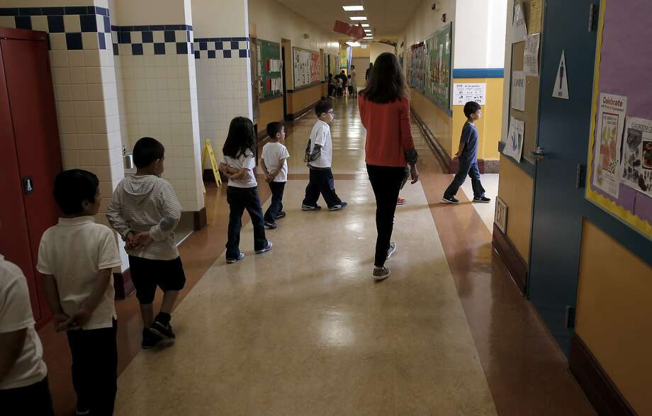 Kindergarten teacher Rebecca Sheehan-Stross, guides her students out to recess  at Cesar Chavez Elementary school in San Francisco, California, on Tues. April 5, 2016. Kindergarten teacher Sheehan-Stross is considering leaving the district after one more school year because she can only afford to rent a dining room in Oakland with no closets and doors that don't close. Photo: Michael Macor, The Chronicle