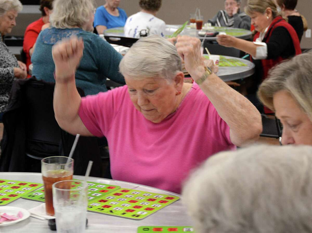 Sue Dean, of the Woodlands, celebrates after seeing that she had a winning bingo card during Bingo for senior citizens at the South County Community Center, 2235 Lake Robbins Drive. Interfaith of The Woodlands sponsors the bingo day. Photograph by David Hopper