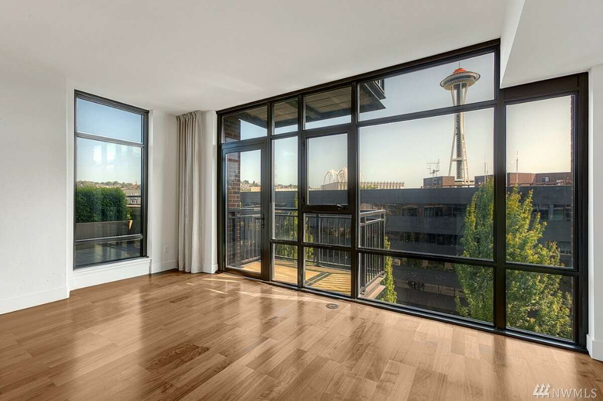 The first home, 2911 2nd Ave. #720, is listed for $769,000. The two-bedroom, 1.75 bathroom-apartment features views of the Space Needle, Elliott Bay and the Olympic Mountains. You can see the full listing here.