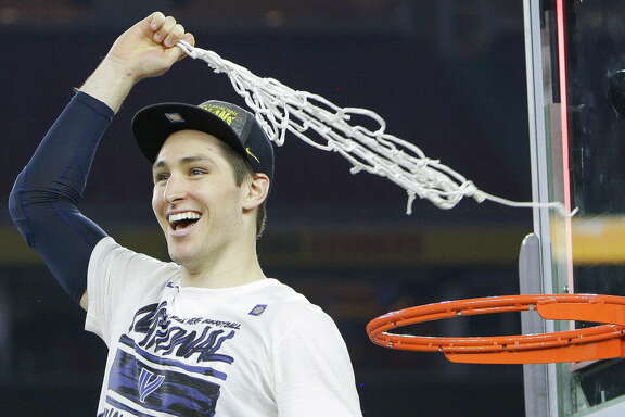 Villanova guard Ryan Arcidiacono (15) swings the net above his head after winning the NCAA National Championship at NRG Stadium, Monday, April 4, 2016, in Houston.