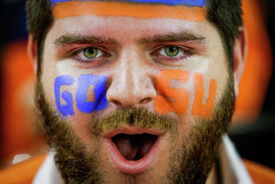 A Syracuse fan cheers before the NCAA Final Four semifinals at NRG Stadium on Saturday, April 2, 2016, in Houston. Photo: Brett Coomer, Houston Chronicle / © 2016 Houston Chronicle