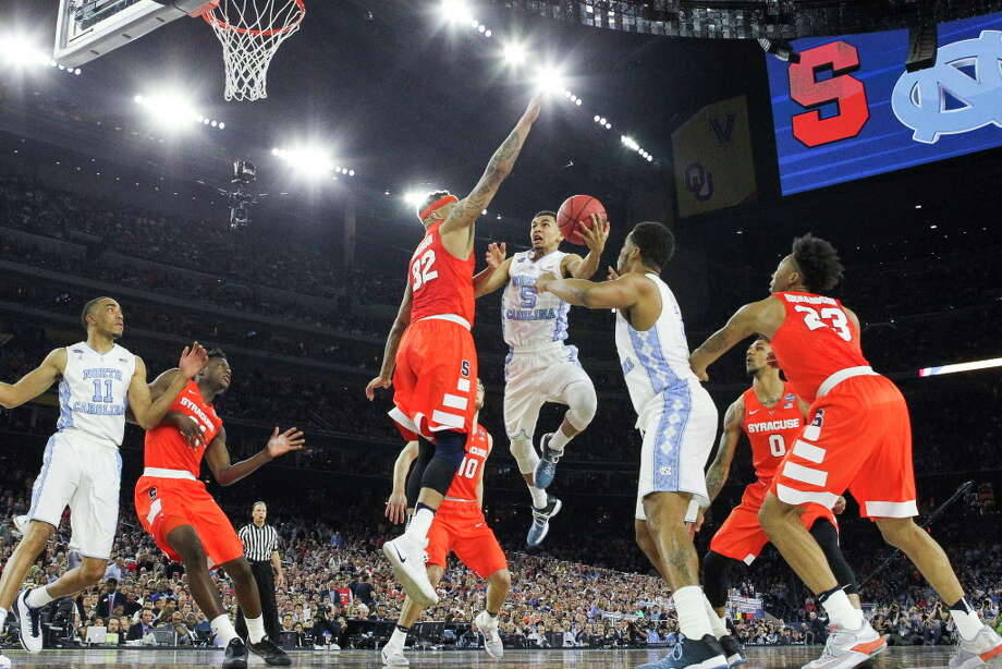 North Carolina guard Marcus Paige (5) takes a shot over Syracuse center DaJuan Coleman (32) during the NCAA Final Four semifinals at NRG Stadium on Saturday, April 2, 2016, in Houston. Photo: Brett Coomer, Houston Chronicle / © 2016 Houston Chronicle