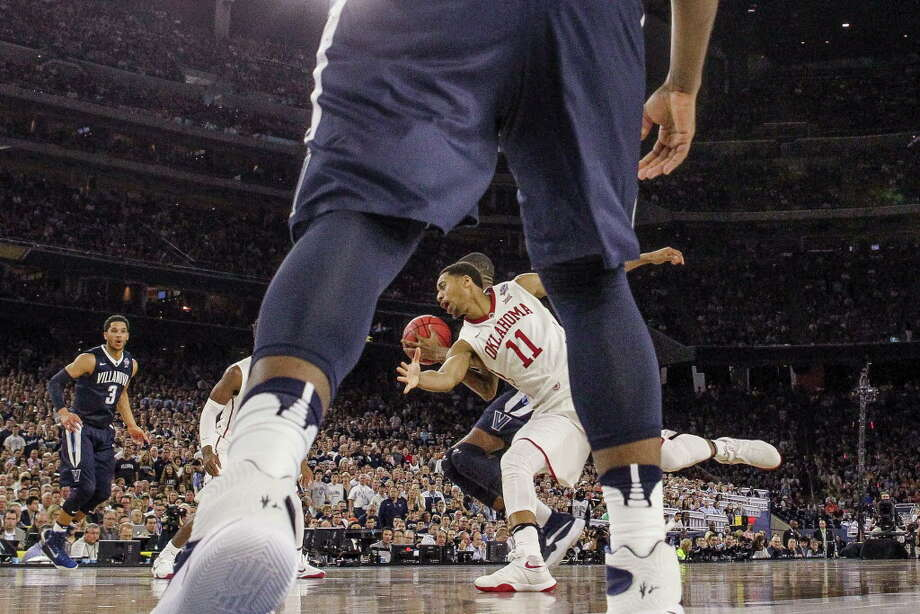 Oklahoma guard Isaiah Cousins (11) attempts to take the ball away from Villanova during the NCAA Final Four semifinals at NRG Stadium on Saturday, April 2, 2016, in Houston. Photo: Brett Coomer, Houston Chronicle / © 2016 Houston Chronicle