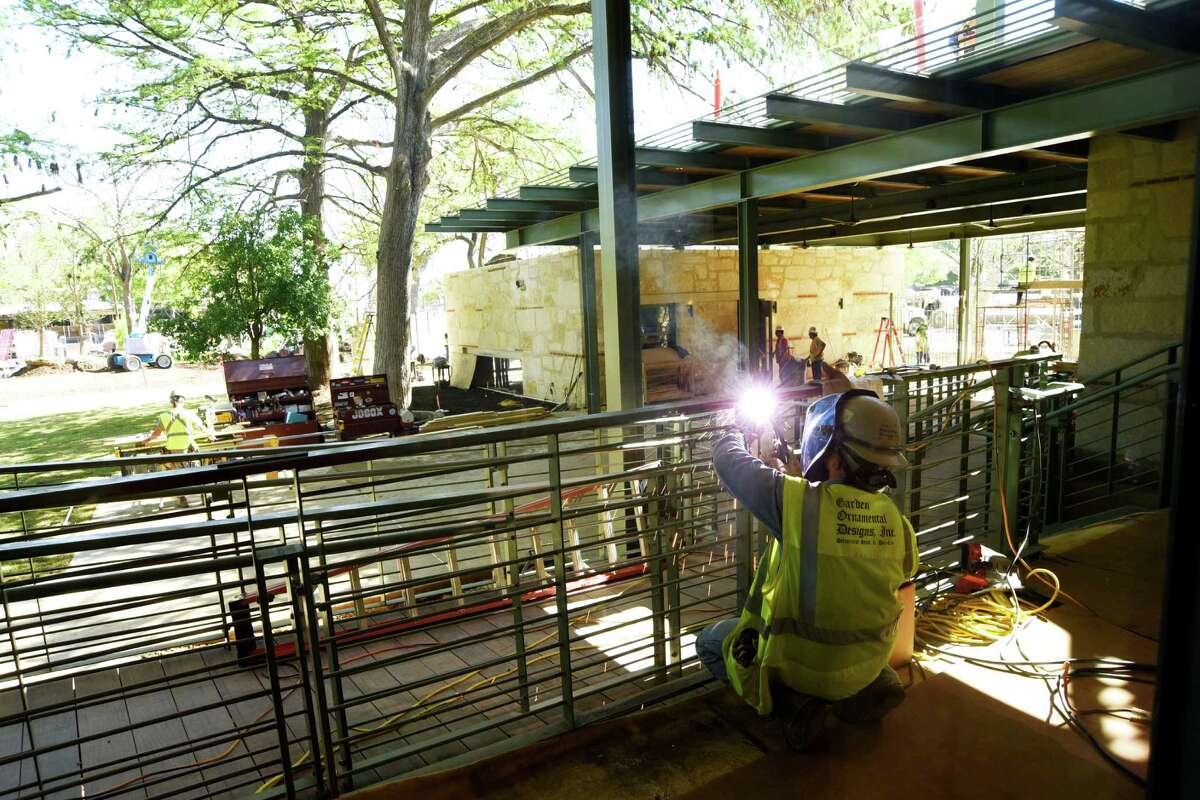 A welder works on a ramp a the new Mays Family Center of the Witte Museum on Tuesday, April 5, 2016. The new exhibition space will open Tuesday.