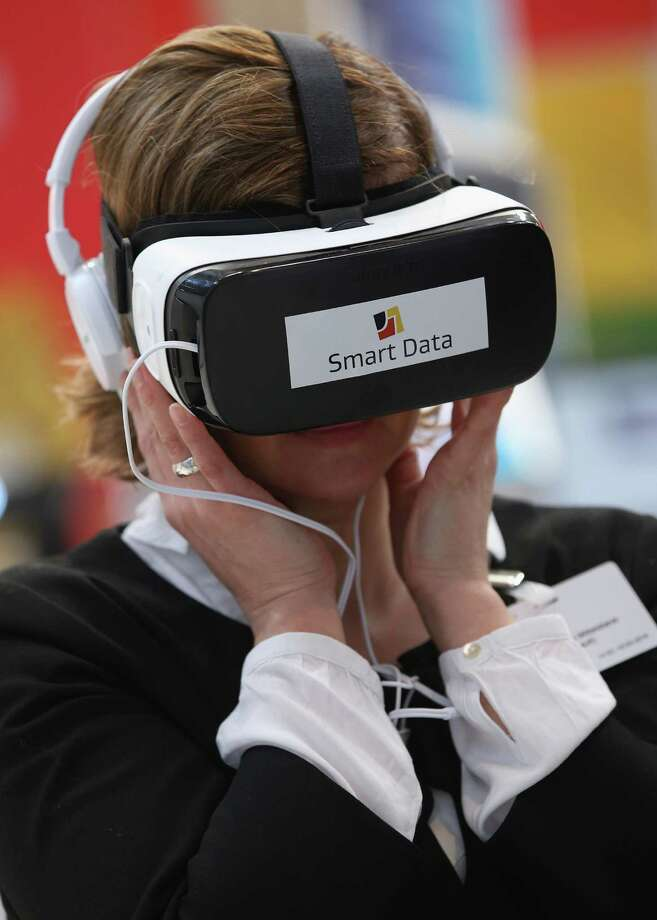 HANOVER, GERMANY - MARCH 14:  A visitor tries out Oculus virtual reality goggles  in Hanover, Germany. The 2016 CeBIT will run from March 14-18.  (Photo by Sean Gallup/Getty Images) Photo: Sean Gallup / 2016 Getty Images