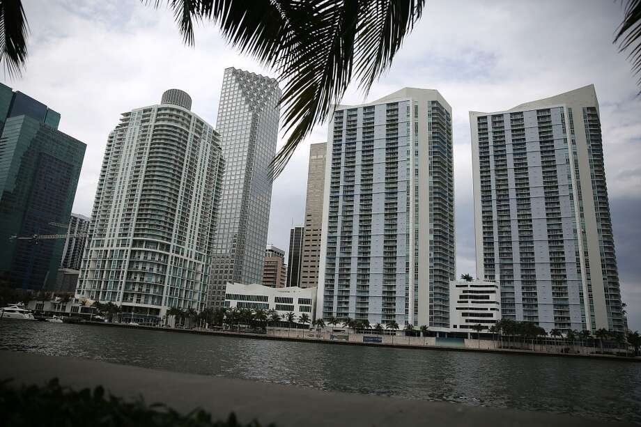 "Skyscrapers and residential buildings line the beach April 4, 2016 in Miami, Florida. A report by the International Consortium of Investigative Journalists referred to as the ""Panama Papers,"" based on information anonymously leaked from the Panamanian law firm Mossack Fonesca, indicates possible connections between condo purchases in South Florida and money laundering. Photo: Joe Raedle, Getty Images"