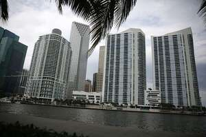 "Skyscrapers and residential buildings line the beach April 4, 2016 in Miami, Florida. A report by the International Consortium of Investigative Journalists referred to as the ""Panama Papers,"" based on information anonymously leaked from the Panamanian law firm Mossack Fonesca, indicates possible connections between condo purchases in South Florida and money laundering."