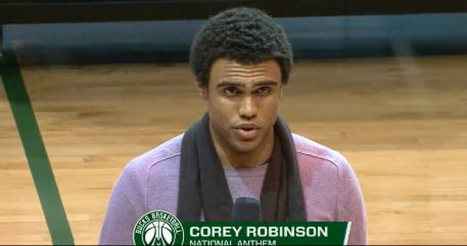 Corey Robinson sings the national anthem April 3, 2016, during the Bulls-Bucks game.