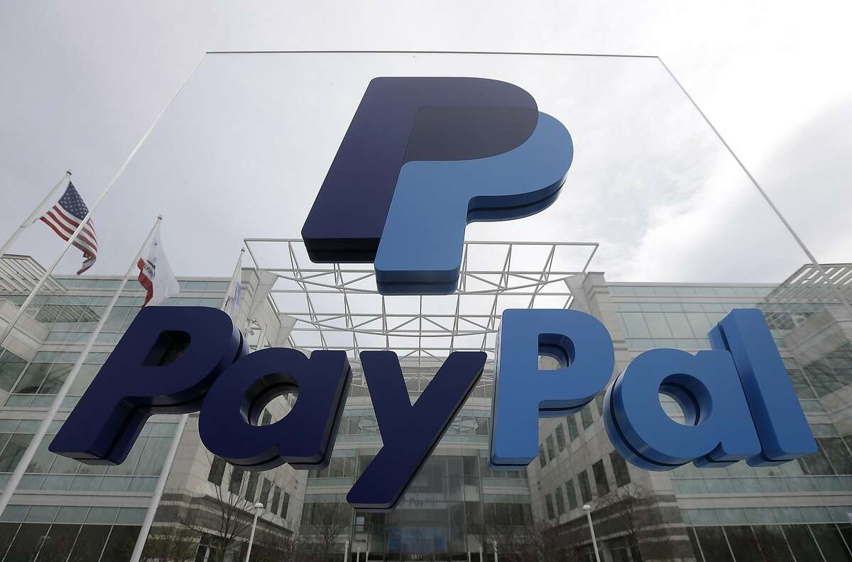FILE - This March 10, 2015, file photo, shows signage outside PayPal's headquarters in San Jose, Calif. PayPal said on Tuesday, April 5, 2016, it's canceling plans to bring 400 jobs to North Carolina after lawmakers passed a law that restricts protections for lesbian, gay, bisexual and transgender people. (AP Photo/Jeff Chiu, File)