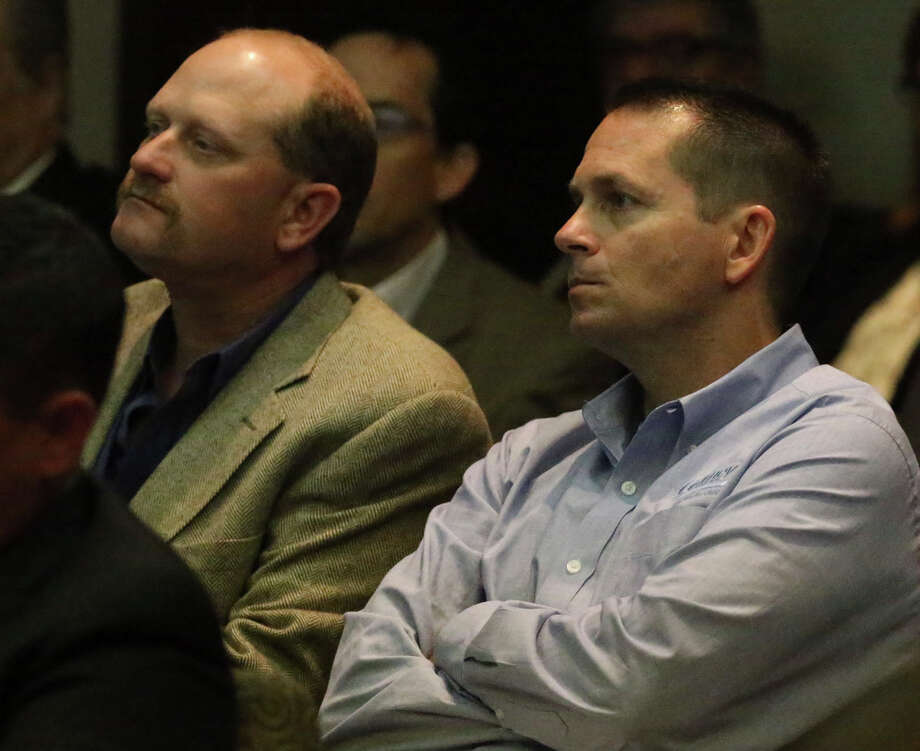 This is Bill Williams (left) and Matt Foster (right) Tuesday April 5, 2016 at the San Antonio Water System headquarters during a Board of Trustees meeting regarding Garney Construction's plan to buy 80 percent of Abengoa's stake in the Vista Ridge pipeline. Williams and Foster work for Garney Construction. Photo: John Davenport, Staff / San Antonio Express-News / ©San Antonio Express-News/John Davenport