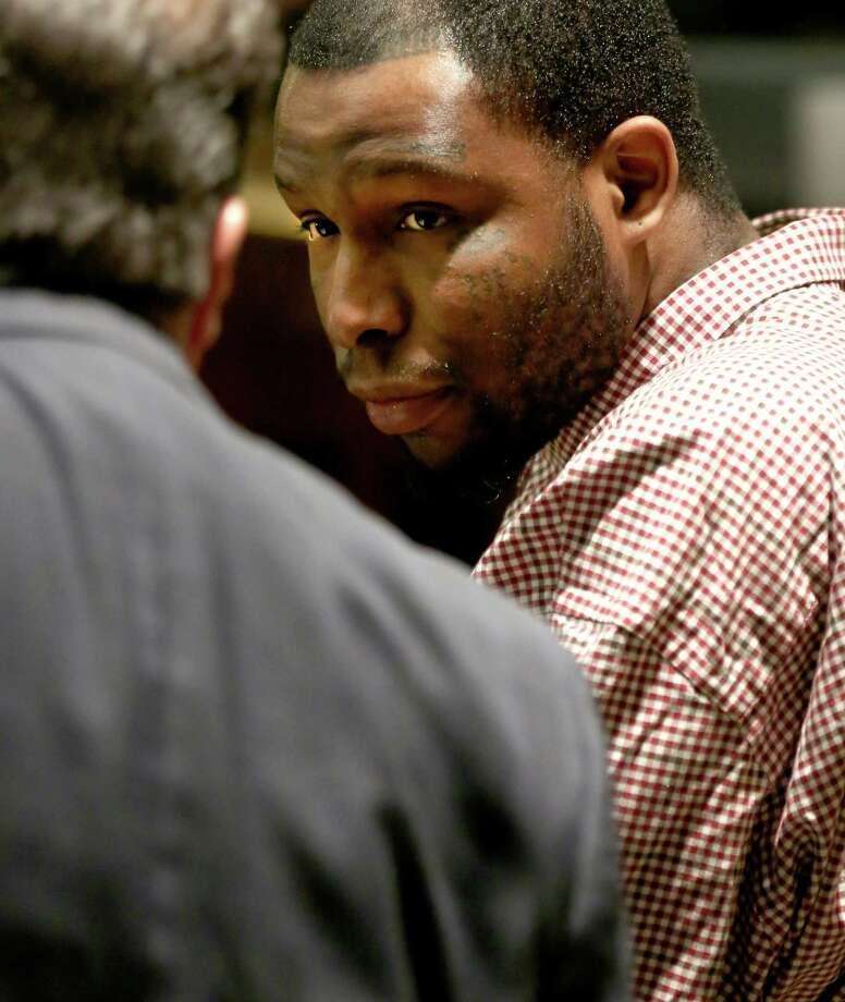 "Clarence William ""Hardcore"" Wright looks at his attorney Tuesday, May 2016 on the first day of his murder trial in the 186th District Court. Wright is accused of killing Jeremiah Gomez, 35 on Oct. 19, 2013. Photo: William Luther, Staff / San Antonio Express-News / © 2016 San Antonio Express-News"