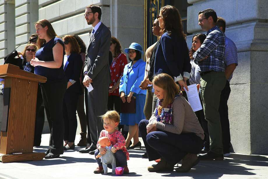 Kim Turner with her daughter, Adelaide Turner Winn, 2, attend a news conference in support of a parental leave bill in San Francisco on Tuesday. Photo: JIM WILSON, NYT