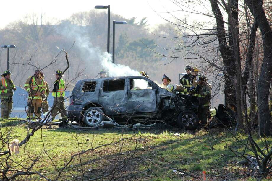 An SUV left the roadway of Interstate 95 southbound in Darien on Tuesday,  April 5, 2016, and caught fire. Emergency responders at the scene would not comment. Photo: Thane Grauel / Hearst Connecticut Media / Stamford Advocate