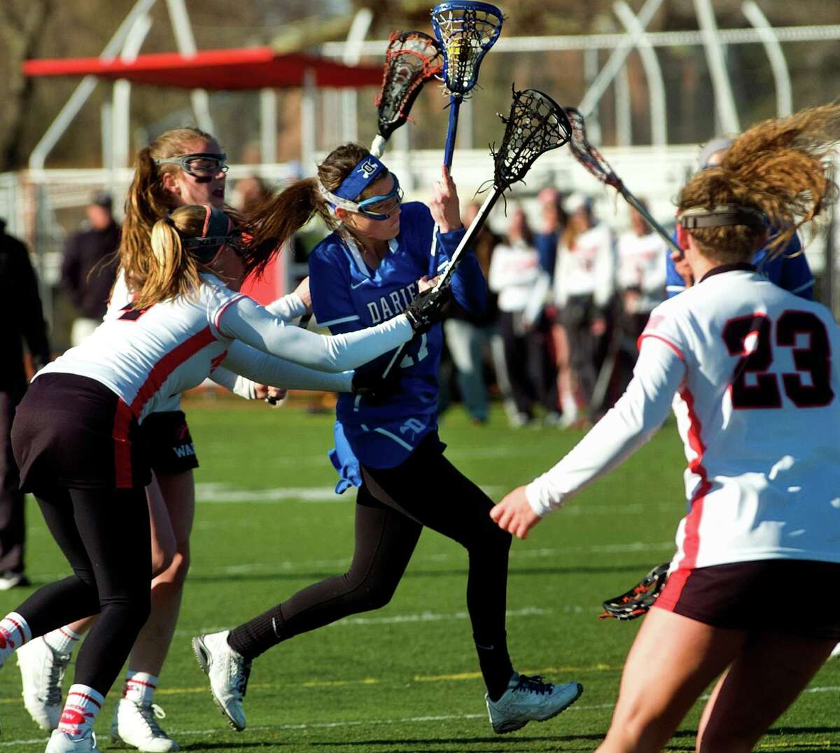 Darien's Chandler Kirby weaves her way to the Fairfield Warde goal to score during girls lacrosse action in Fairfield, Conn., on Tuesday Apr. 5, 2016.