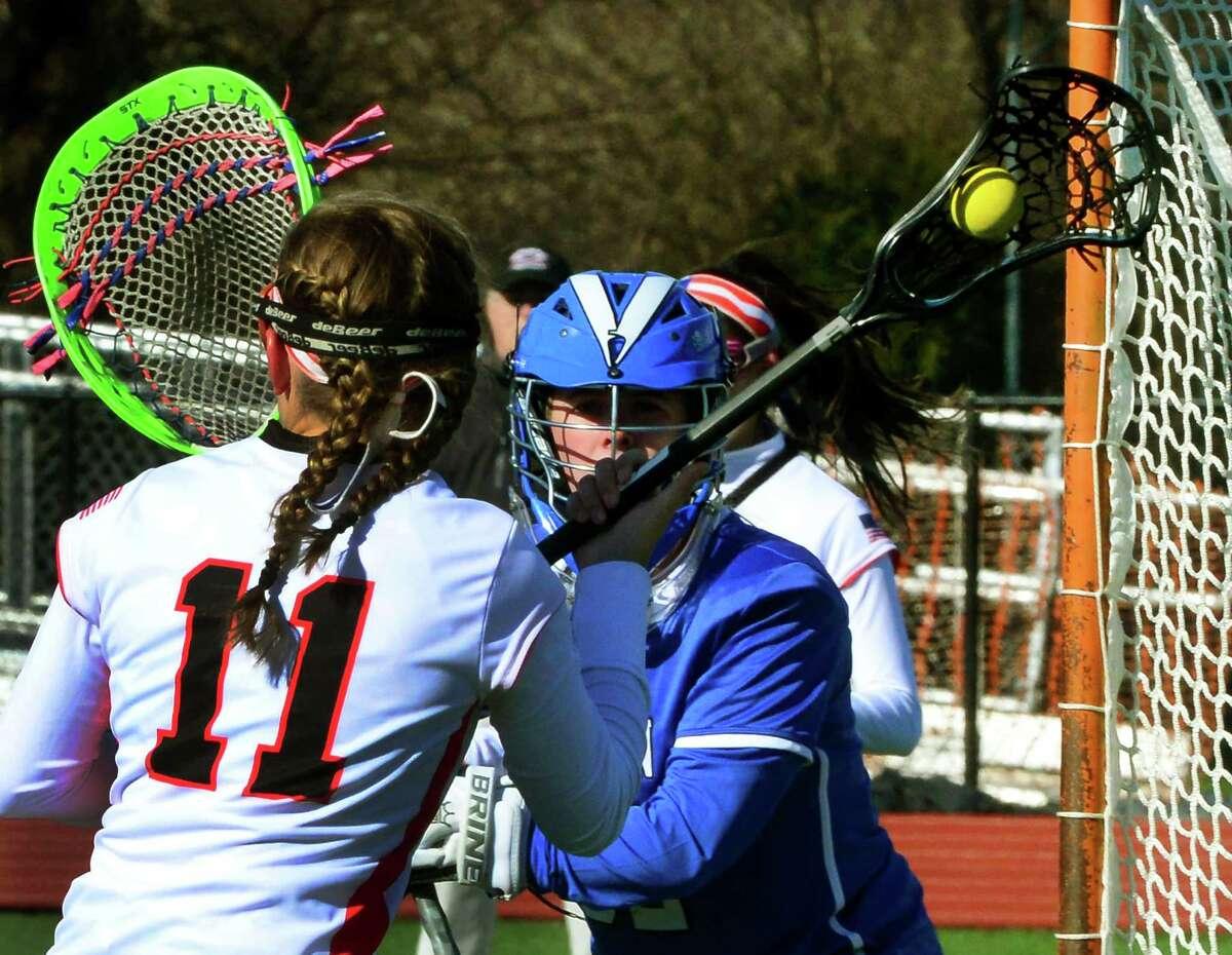 Darien goalie Carly Schoudel tracks Fairfield Warde's Amanda Orvis during girls lacrosse action in Fairfield, Conn., on Tuesday Apr. 5, 2016.