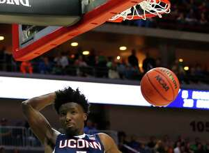 The Hartford Courant is reporting that UConn sophomore Daniel Hamilton intends to hire an agent and stay in the NBA Draft.