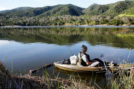 Shane Clifton looks out across the water while fishing in his kayak on Lake Del Valle at Del Valle Regional Park in Livermore, California, on Monday, April 4, 2016.