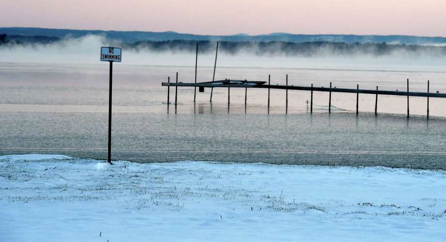 As what appears to steam comes from the surface no one would be interested in swimming in Saratoga Lake on Tuesday morning, April 5, 2016, in in almost record cold at 9 degree weather in Stillwater, N.Y.   (Skip Dickstein/Times Union) Photo: SKIP DICKSTEIN