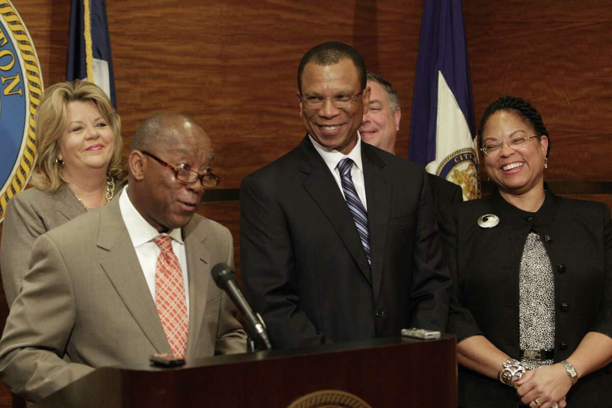Houston Mayor Sylvester Turner, left, on Tuesday named prviate-sector lawyer Ronald Lewis, center, as his pick for city attorney, whose office offers legal guidance and handles investigations. Lewis is one of Turner's first additions.