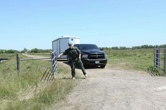 Crews leave the Brazoria County field Tuesday that may hold the answer to Kelli Cox's disappearance.
