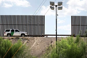 A U.S. Customs and Border Protection vehicle is positioned along the border wall near the Hidalgo Bridge in the Rio Grande Valley, on Thursday June 27, 2013.