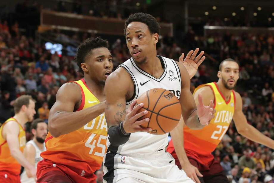 San Antonio Spurs guard DeMar DeRozan (10) looks to get past Utah Jazz guard Donovan Mitchell (45) and to the basket during the fourth quarter of an NBA basketball game, Saturday, Feb. 9, 2019, in Salt Lake City. Utah won 125-105. (AP Photo/Chris Nicoll) Photo: Chris Nicoll, Associated Press / Copyright 2019 The Associated Press. All rights reserved.