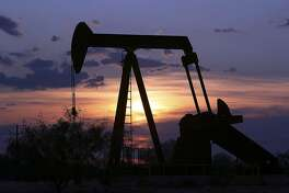 Oil Well pump is silouetted against the West Texas sunset near Big Lake Tuseday August 22, 2006. DELCIA LOPEZ/STAFF