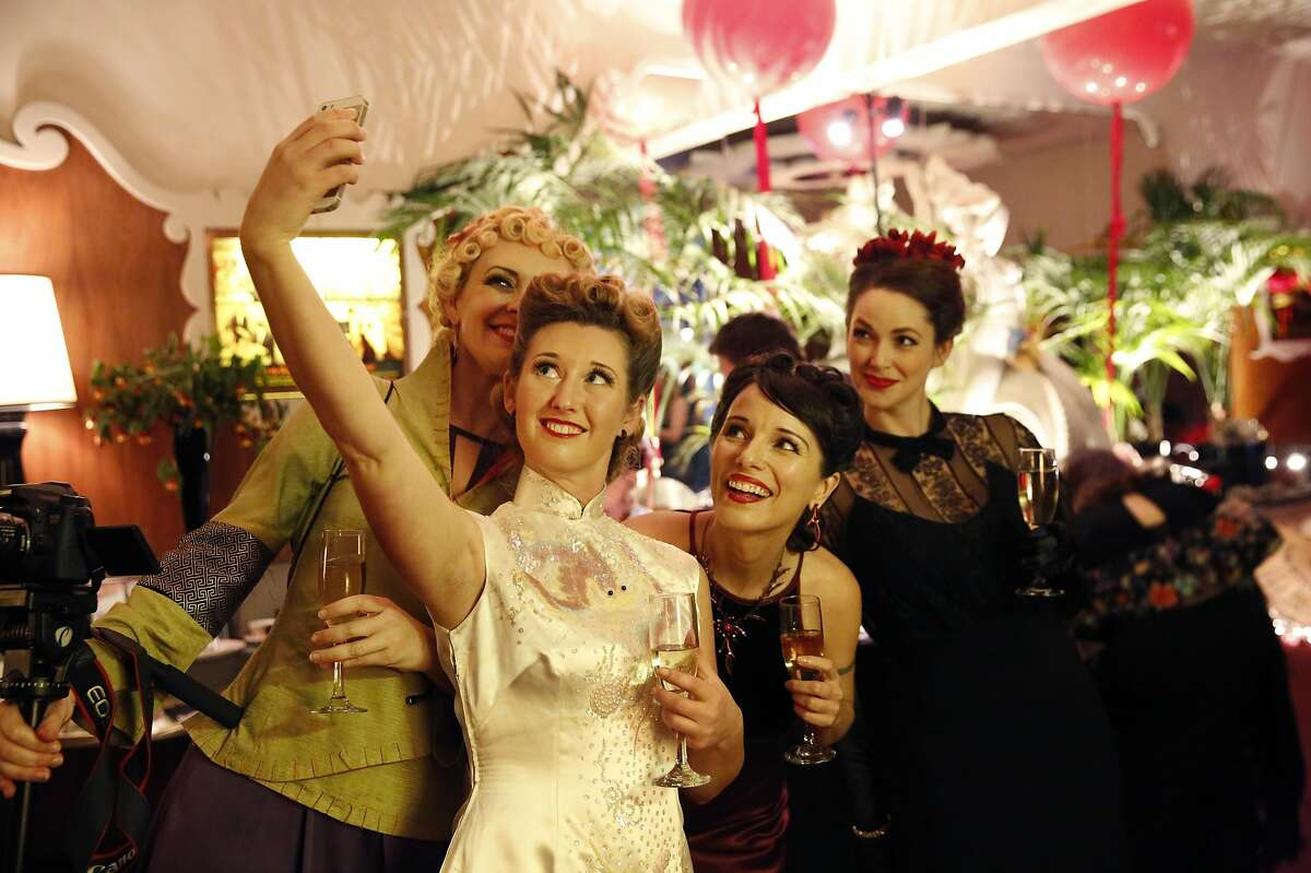 Decobelles, from left, Stefani Pelletier, Vanessa Yakobovich, Sarah Rice and Lindsay Ferguson pose for a group selfie during the Art Deco Society of California's 32nd annual Art Deco Preservation Ball at Bimbo's 365 Club April 2, 2016 in San Francisco, Calif.