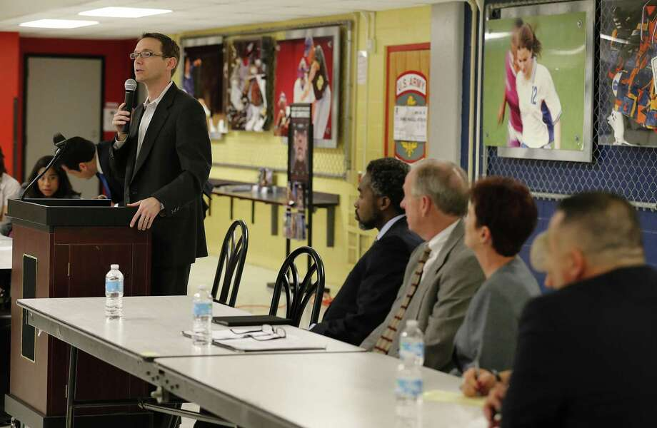 State education commissioner Mike Morath (left) addresses a crowded room of parents and educators from Edgewood Independent School District in 2016. The appointed Edgewood board should have let Morath fill a vacated seat. Photo: Kin Man Hui /San Antonio Express-News / ©2016 San Antonio Express-News