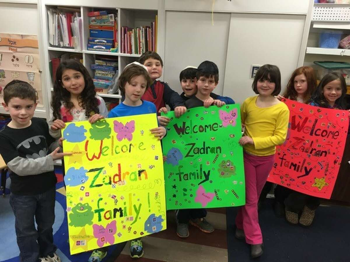 Second-grade students from B'Yachad Hebrew School in Albany made welcome signs to brighten up the new apartments of Afghan refugee families, which members of Ohav Shalom in Albany fully furnished with donations and volunteer labor (Photo courtesy of Judith Avner)