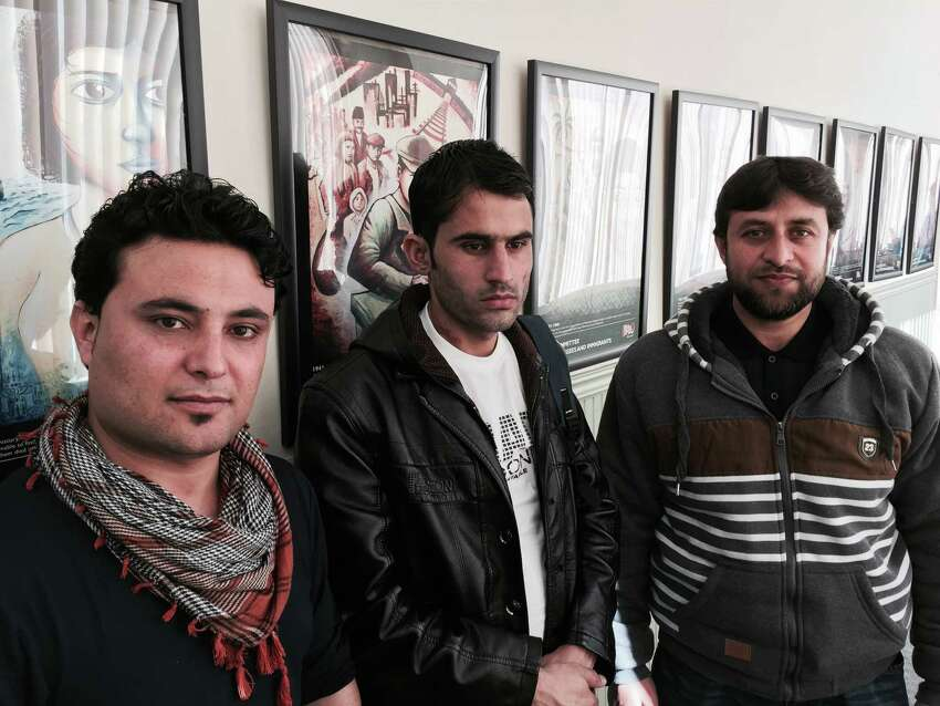 From left, Afghan refugees Abdul Sami Shayeq, 25, Babark Haidari, 22, and Sayeed Ahmad Noor, 36, talk about their long, difficult journeys from their embattled homeland and being resettled in Albany with the help of volunteers from Ohav Shalom in Albany. (Paul Grondahl / Times Union)