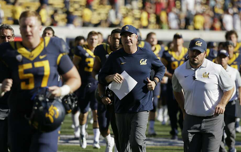 California head coach Sonny Dykes, center,  runs off the field with his team at the end of an NCAA college football game against Southern California Saturday, Oct. 31, 2015, in Berkeley, Calif. USC won the game 27-21. (AP Photo/Eric Risberg) Photo: Eric Risberg, Associated Press