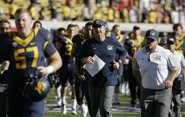 California head coach Sonny Dykes, center,  runs off the field with his team at the end of an NCAA college football game against Southern California Saturday, Oct. 31, 2015, in Berkeley, Calif. USC won the game 27-21. (AP Photo/Eric Risberg)
