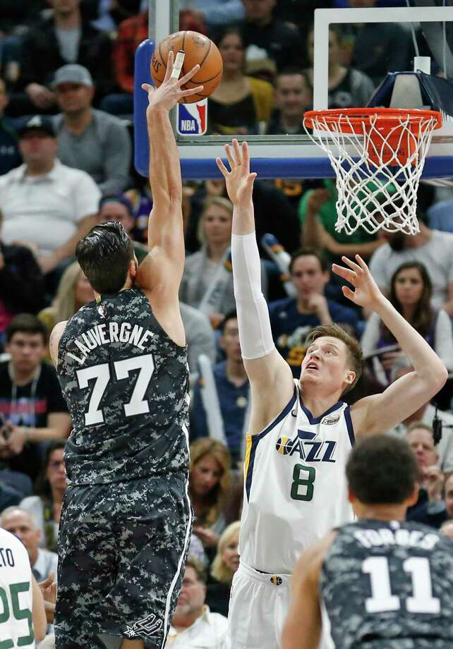 San Antonio Spurs center Joffrey Lauvergne (77) shoots as Utah Jazz forward Jonas Jerebko (8) defends in the first half of an NBA basketball game Monday, Feb. 12, 2018, in Salt Lake City. (AP Photo/Rick Bowmer) Photo: Rick Bowmer, Associated Press / Copyright 2018 The Associated Press. All rights reserved.