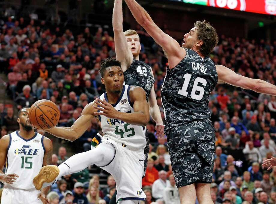 San Antonio Spurs center Pau Gasol, right, drives around Utah Jazz center Rudy Gobert (27) during the first half of an NBA basketball game Wednesday, April 12, 2017, in Salt Lake City. (AP Photo/Rick Bowmer) Photo: Rick Bowmer, Associated Press / Copyright 2017 The Associated Press. All rights reserved.