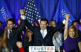Republican presidential candidate Sen. Ted Cruz, R-Texas, raises hands with Wisconsin Gov. Scott Walker, left, and his wife Heidi, right, during a primary night campaign event, Tuesday, April 5, 2016, in Milwaukee. (AP Photo/Paul Sancya)