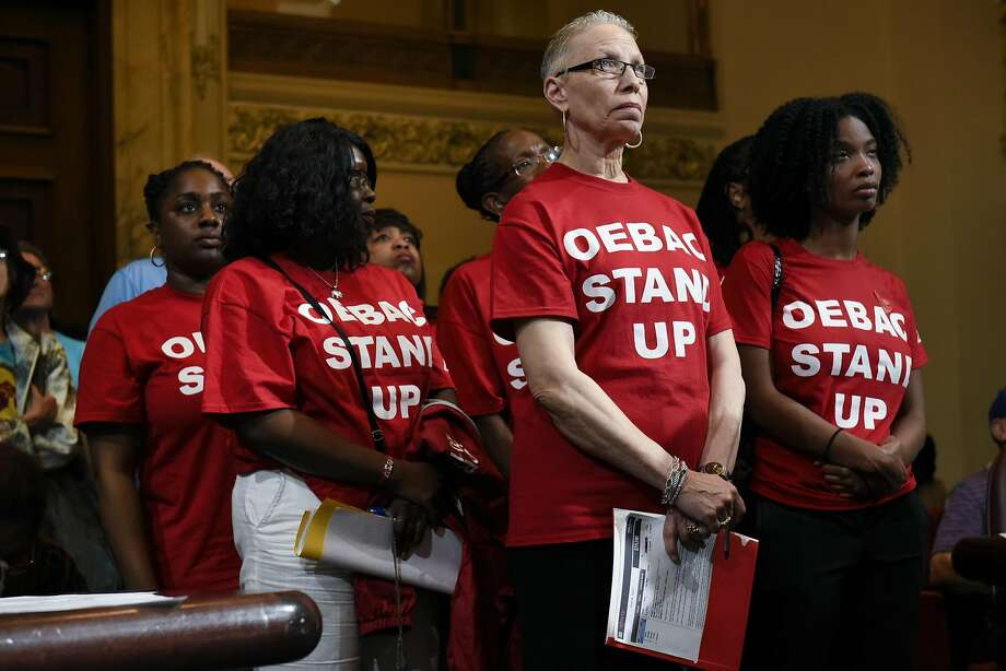 Lynn Haines Dodd, center, waits with other members of the Oakland East Bay Alumnae Chapter of Delta Sigma Theta to speak out against rental prices during the public comment portion of an Oakland City Council meeting held to decide whether to impose a 90-day moratorium on no-cause evictions and rent increases for Oakland residents, at City Hall in Oakland, CA, Tuesday, April 5, 2016. Photo: Michael Short, Special To The Chronicle
