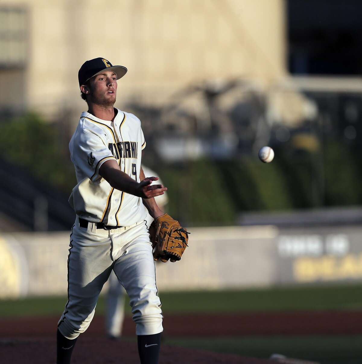 Cal starting pitcher Tanner Dodson (19) flips the ball to first base for the out in the first inning as the California Golden Bears played the Stanford Cardinal at Evans Diamond in Berkeley, Calif., on Tuesday, April 5, 2016.